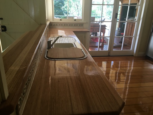 Flooring and bench top refinished for a brand new kitchen look